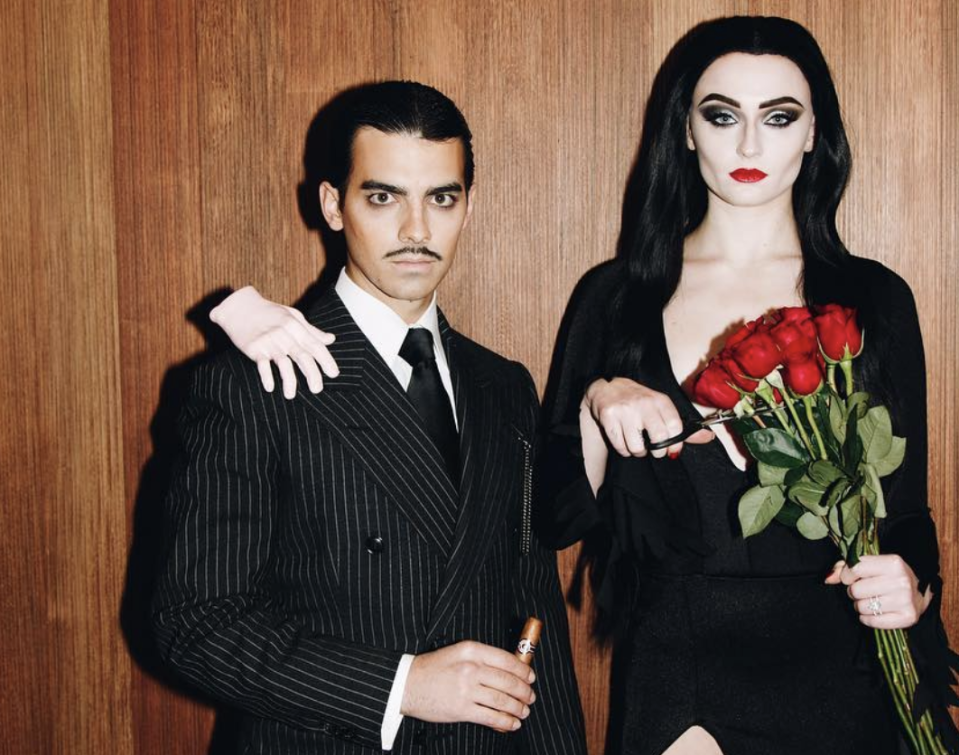 <p>As Gomez and Morticia Adams.</p>