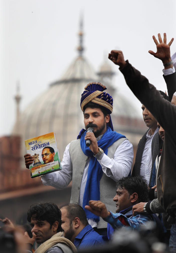 Chandrashekhar Azad, leader of the Bhim Army, a political party of Dalits who represent the Hinduism's lowest caste, center, speaks during a protest against a new Citizenship law, after Friday prayers in New Delhi, India, Friday, Jan. 17, 2020. Protests against India's citizenship law that excludes Muslim immigrants continue in Indian cities in an unabating strong show of dissent against the Hindu nationalist government of Prime Minister Narendra Modi. Azad was arrested on Dec. 21 after leading a similar protest at the steps of the 17th century Jama Masjid mosque, accused of instigating violence as the protest had ended in a clash between the protesters and the police. He was ordered released from prison on Thursday by a New Delhi court. (AP Photo/Manish Swarup)