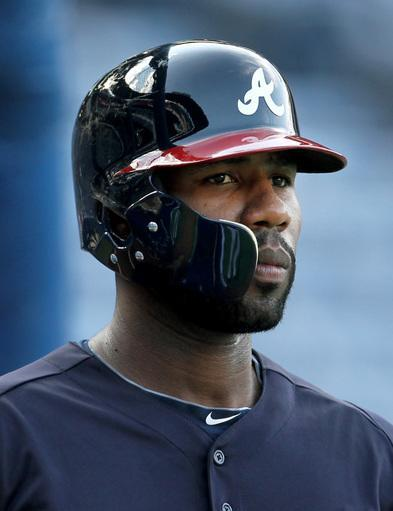Atlanta Braves' Jason Heyward wears a batting helmet with a protective shield before the Braves host the San Diego Padres at Turner Field, Friday, Sept. 13, 2013, in Atlanta. Heyward attended batting practice with the team for the first time since he fractured his jaw when hit by a pitch from the Mets' Jonathon Niese on Aug. 21. (AP Photo/Atlanta Journal-Constitution, Jason Getz)