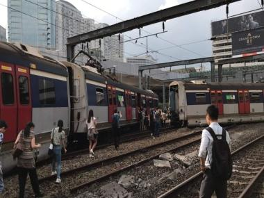 Three injured as train derails in Hong Kong during rush hour, MTR Corporation suspends services between two stations on East Rail line