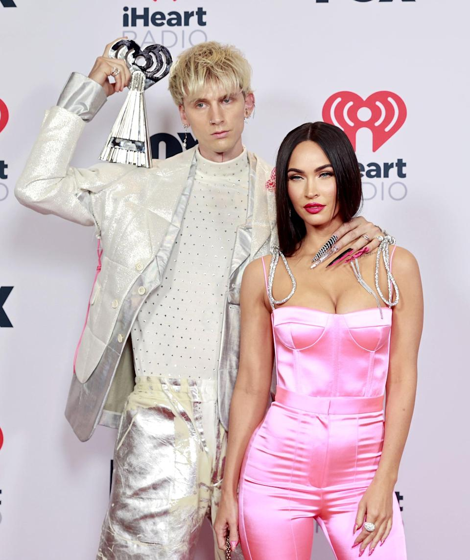 """<ul> <li><strong>What to wear for Machine Gun Kelly: </strong>Machine Gun Kelly and <a class=""""link rapid-noclick-resp"""" href=""""https://www.popsugar.com/Megan-Fox"""" rel=""""nofollow noopener"""" target=""""_blank"""" data-ylk=""""slk:Megan Fox"""">Megan Fox</a> know how to dress to impress. The <a href=""""https://www.popsugar.com/fashion/megan-fox-pink-jumpsuit-iheartradio-music-awards-2021-48347878"""" class=""""link rapid-noclick-resp"""" rel=""""nofollow noopener"""" target=""""_blank"""" data-ylk=""""slk:pair showed up to the iHeartRadio Music Awards"""">pair showed up to the iHeartRadio Music Awards</a> earlier this year in stylish fashion wearing flashy outfits that complemented each other in the shiniest of ways - plus, take a look at those nails on MGK! To copy MGK, wear a silver suit jacket with silver shorts, white socks with pink stripes, and long nails.</li> <li><strong>What to wear for Megan Fox:</strong> Megan's pink Malibu Barbie-styled jumpsuit is all you need, plus a hot-pink lip to top it off!</li> </ul>"""
