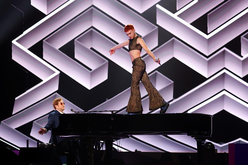 LONDON, ENGLAND - MAY 11:  Sir Elton John and Olly Alexander perform during The BRIT Awards 2021 at The O2 Arena on May 11, 2021 in London, England. (Photo by JMEnternational/JMEnternational for BRIT Awards/Getty Images)