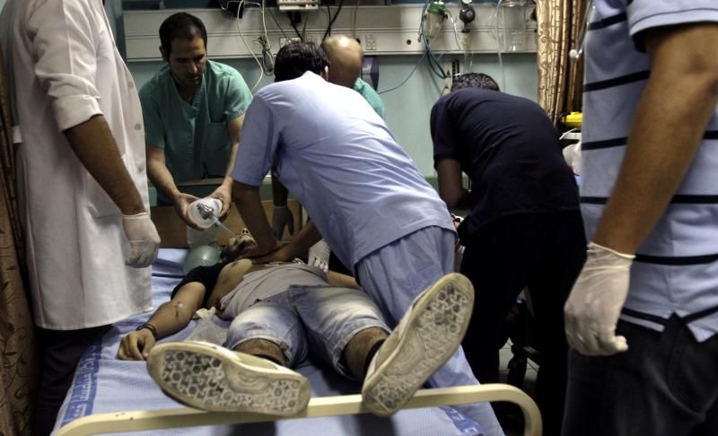 Doctors try to save the life of fatally shot Majd Lahlouh, 22, at a hospital in the West Bank town of Jenin, Tuesday, Aug. 20, 2013. Lahlouh was killed after Israeli soldiers came under fire during an arrest raid, the Israeli military said. (AP Photo/Mohammed Ballas)