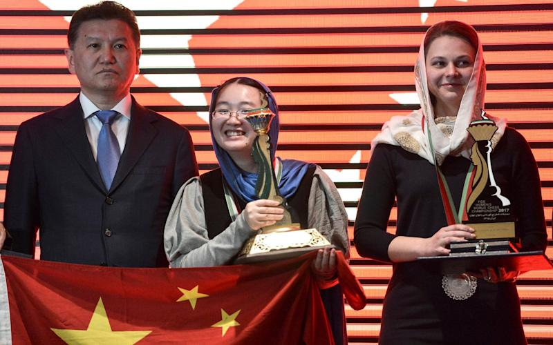 Kirsan Ilyumzhinov (left) at the presentation ceremony for the Women's World Chess Championship final in Tehran, Iran - EPA