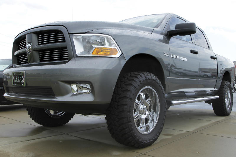 The Dodge logo is seen on a new Dodge RAM 1500 pickup truck for sale at an auto dealership Sunday, June 24, 2012 in Springfield, Ill.  GM's August U.S. sales rose 10 percent compared with a year earlier, while Ford's rose 13 percent and Chrysler's 14 percent. (AP Photo/Seth Perlman)