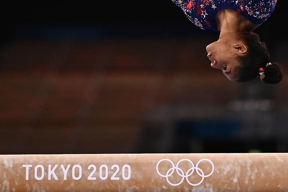 <p>USA's Jordan Chiles competes in the artistic gymnastics balance beam event of the women's qualification during the Tokyo 2020 Olympic Games at the Ariake Gymnastics Centre in Tokyo on July 25, 2021. (Photo by LOIC VENANCE / AFP) (Photo by LOIC VENANCE/AFP via Getty Images)</p>