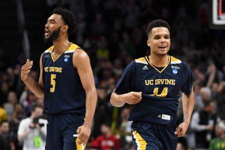 Mar 22, 2019; San Jose, CA, USA; UC Irvine Anteaters guard Evan Leonard (14) and forward Jonathan Galloway (5) react after the win in the first round of the 2019 NCAA Tournament at SAP Center. Mandatory Credit: Kelley L Cox-USA TODAY Sports