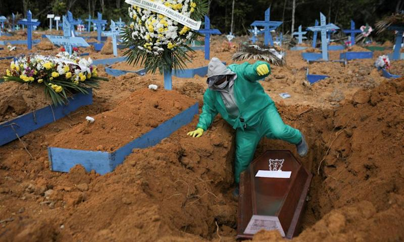 A gravedigger works during a funeral in Manaus, Brazil, which has one the continent's deadliest outbreaks.