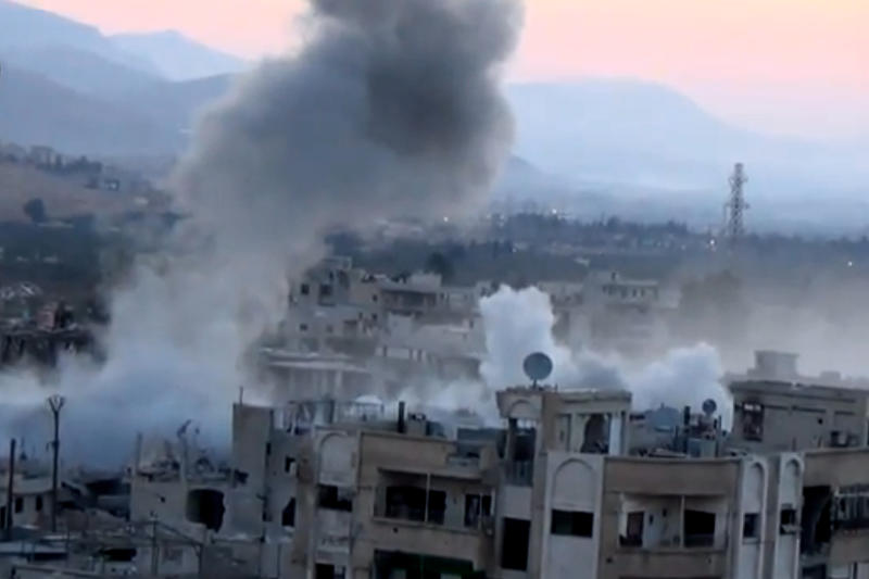 In this image taken from video obtained from the Shaam News Network, which has been authenticated based on its contents and other AP reporting, smoke rises from buildings due to heavy artillery shelling in Barzeh, a district of Damascus, Syria, Tuesday, Sept. 10, 2013. (AP Photo/Shaam News Network via AP video)
