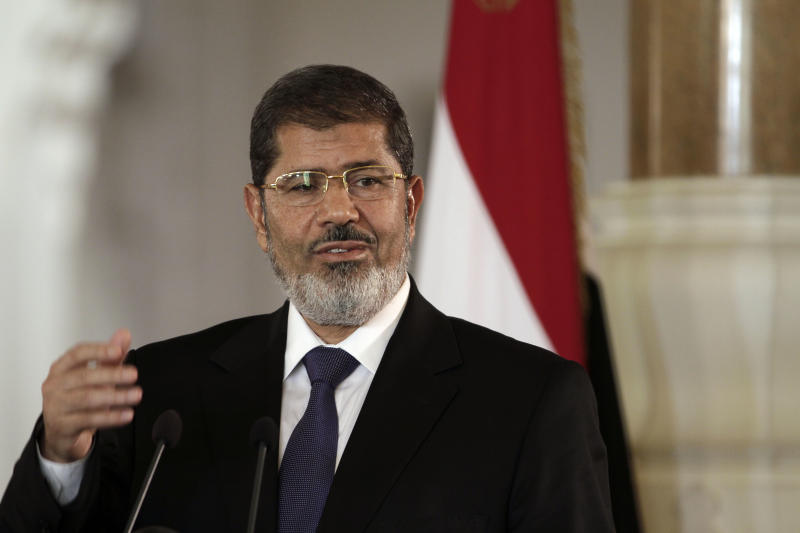 FILE - In this Friday, July 13, 2012 file photo, Egyptian President Mohammed Morsi speaks to reporters during a joint news conference with Tunisian President Moncef Marzouki, unseen, at the Presidential palace in Cairo, Egypt. Egypt's Islamist president has appointed on Tuesday, Sept. 4, 2012, 10 new governors, four of them leading members of his fundamentalist Muslim Brotherhood group. The Islamist-led upper house of parliament, the Shura Council, also appointed ultraconservative Islamists as members of state-run human rights and media councils. Egypt is divided into 27 provinces or governorates, each headed by a governor. Of the 10 governors appointed by President Mohammed Morsi on Tuesday, four are Muslim Brotherhood members and three are former army generals.(AP Photo/Maya Alleruzzo, File)