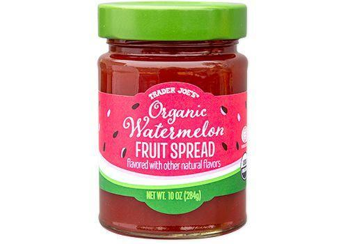 """<p>Trader Joe's has got the seasonal items on lock, which is what inspires treats like this Organic Watermelon Fruit Spread. Enjoy 'em sparingly because they don't quite equate to an every day indulgence. """"These don't get a passing grade when it comes to containing added sugars and the ever broad 'flavored with other natural flavors,'"""" says John Fawkes, NSCA-Certified personal trainer, Precision Nutrition-certified nutritionist, & Managing Editor at <a href=""""https://the-unwinder.com/"""" rel=""""nofollow noopener"""" target=""""_blank"""" data-ylk=""""slk:The Unwinder"""" class=""""link rapid-noclick-resp"""">The Unwinder</a>. """"Natural flavors can just mean so many things."""" </p>"""