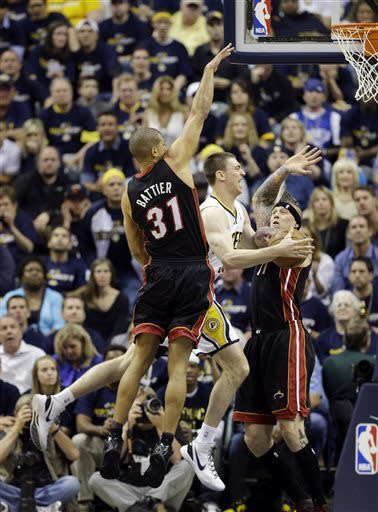 Indiana Pacers' Tyler Hansbrough puts up a shot against Miami Heat defenders Shane Battier (31) and Chris Andersen (11) during the first half of Game 3 of the NBA Eastern Conference basketball finals in Indianapolis, Sunday, May 26, 2013. (AP Photo/Nam H. Huh)