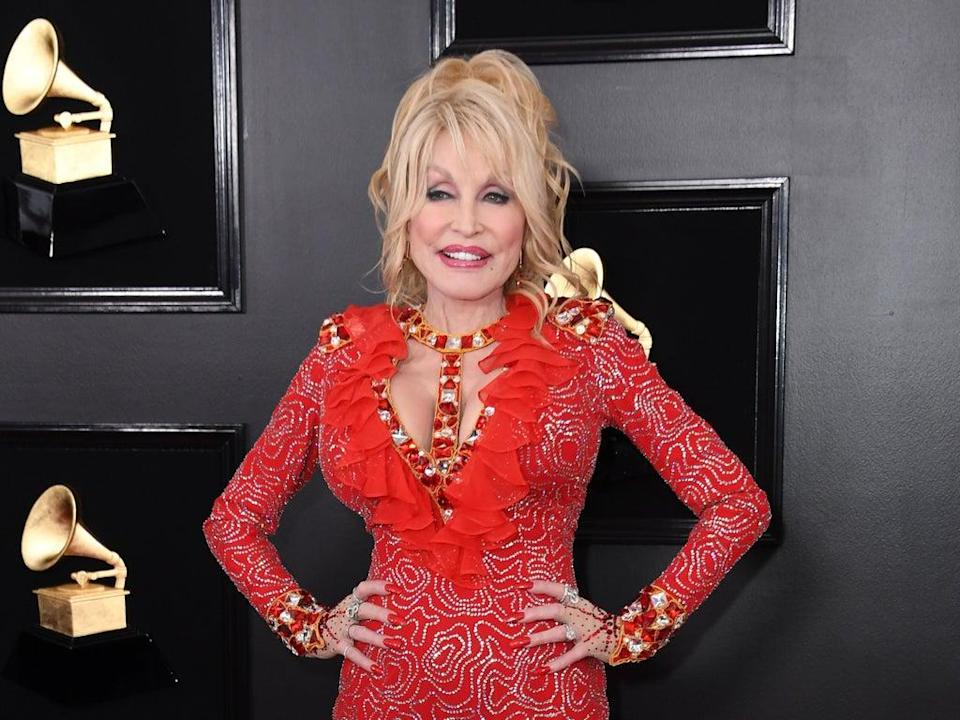 Dolly Parton opens up about tattoo collection (AFP via Getty Images)