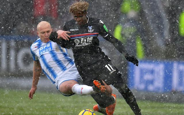 "Andros Townsend believes fellow Crystal Palace winger Wilfried Zaha can handle the rough stuff and inspire the Eagles to Premier League survival. Remarkably, Palace have not earned a single point this season without Zaha in the side. On his first start since the beginning of February after a spell out injured Zaha helped Palace to return winning ways at Huddersfield. Zaha left the pitch with his shins bruised after a few hefty challenges from Huddersfield's players, but Townsend reckons he is tough enough to take the kicks. ""When you're as good as Wilf and when you're the team's talisman you have to take that punishment,"" he said. ""The likes of Eden Hazard and Harry Kane take the same tackles. Wilf is robust enough and strong enough to ride those challenges and get on with the game. Zaha was forced off after being targeted by the Huddersfield players - something Townsend says he musy get used to Credit: Reuters ""The most impressive thing about him against Huddersfield is that he didn't let it affect him, he didn't lose his head. ""He kept getting on the ball and he kept taking people on and you can't ask for any more than that from a player."" James Tomkins put Palace ahead at the John Smith's Stadium when he poked home from a corner before Luka Milivojevic added a second from the penalty spot after Mathias Jorgensen brought down Townsend. However, it was Zaha's attacking presence which brought belief to a Palace side which had not won in seven and suffered four consecutive defeats before this result. ""Wilf coming back gives us a massive boost,"" Townsend added. ""He's an incredible player for us. We need to keep him fit if we're going to stay up."" My favourite ever Premier League player Only West Brom have a worse points haul than Huddersfield since the turn of the year but Terriers boss David Wagner insists his side will relish the thrill of beating the drop. ""I don't have the feeling that the players are starting to panic or we are in the mood to panic,"" Wagner said. ""In general the season gets more exciting at the end. The good thing is nobody thought it would be exciting for us as well because everyone thought we would be at the bottom."""