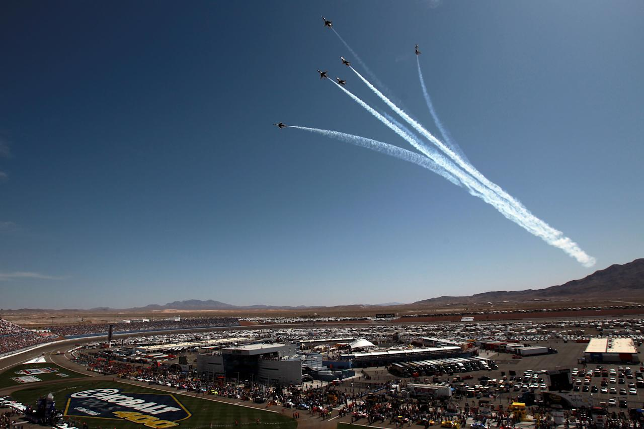LAS VEGAS, NV - MARCH 11:  The United States Air Force Thunderbirds fly over during the national anthem prior to the start of the NASCAR Sprint Cup Series Kobalt Tools 400 at Las Vegas Motor Speedway on March 11, 2012 in Las Vegas, Nevada.  (Photo by Ronald Martinez/Getty Images for NASCAR)