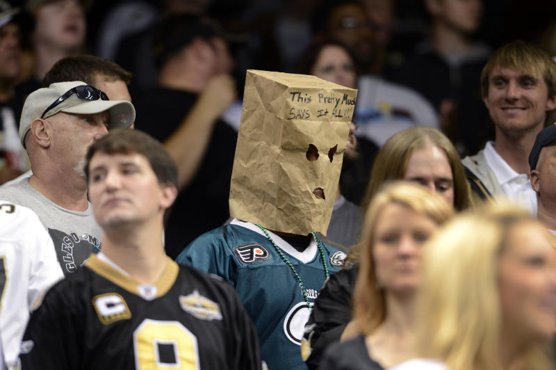 A Philadelphia Eagles fan wears a bag on his head during the second half an NFL football game against the New Orleans Saints at the Mercedes-Benz Superdome in New Orleans, Monday, Nov. 5, 2012. The Saints won 28-13. (AP Photo/Bill Feig)