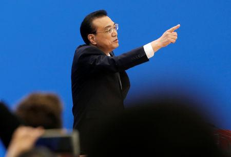 Chinese Premier Li Keqiang gestures as he leaves at the end of a news conference following the closing session of the National People's Congress (NPC) at the Great Hall of the People in Beijing, China March 15, 2019. REUTERS/Thomas Peter