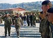 A French Army general (2nd L) and Afghan National Army general (L) review Afghan and French troops during a handover ceremony at France's Camp Nijrab in Kapisa province. France ended its combat mission in Afghanistan on Tuesday, withdrawing troops from a strategic province northeast of Kabul as part of a quickened departure from the war-torn country