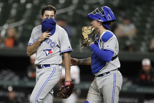 Toronto Blue Jays relief pitcher Derek Law, left, talks to catcher Reese McGuire during the ninth inning of the team's baseball game against the Baltimore Orioles, Wednesday, Sept. 18, 2019, in Baltimore. The Blue Jays won 11-10. (AP Photo/Julio Cortez)