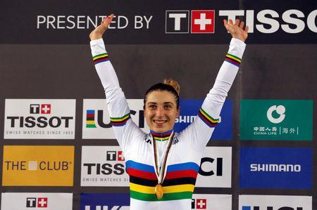 Cycling - UCI Track World Championships - Women's 500m Time Trial Final - Hong Kong, China - 15/4/17 - Russia's Daria Shmeleva poses with her gold medal. REUTERS/Bobby Yip