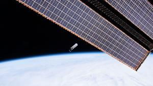The Hyper-Angular Rainbow Polarimeter small satellite is shown in this February 19, 2020, photo shortly after it was deployed into orbit from the International Space Station. Manufactured by the Space Dynamics Laboratory to carry the payload built by the Earth and Space Institute at the University of Maryland, Baltimore County, the HARP satellite was honored with the Small Satellite Mission of the Year award today.  (Credit: NASA)