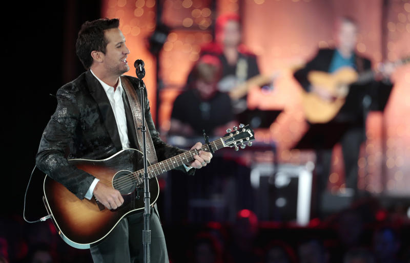 Luke Bryan performs during a tribute to songwriter Dean Dillon at the BMI Country Awards on Tuesday, Nov. 5, 2013, in Nashville, Tenn. (AP Photo/Mark Humphrey)