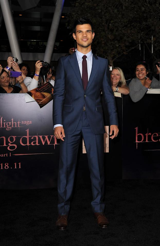 """LOS ANGELES, CA - NOVEMBER 14:  Actor Taylor Lautner arrives at the premiere of Summit Entertainment's """"The Twilight Saga: Breaking Dawn - Part 1"""" at Nokia Theatre L.A. Live on November 14, 2011 in Los Angeles, California.  (Photo by Kevin Winter/Getty Images)"""