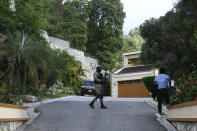 A Haitian police officer guards the residence President Jovenel Moise in Port-au-Prince, Haiti, Thursday, July 15, 2021, as FBI agents assisting the investigation of his assassination inspect the house. (AP Photo/Matias Delacroix)