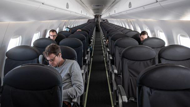 PHOTO: An almost empty British Airways passenger plane flies from Milan to London on March 5, 2020. (Laurel Chor/Getty Images, FILE)