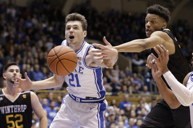 Duke forward Matthew Hurt (21) and Winthrop guard Micheal Anumba reach for the ball during the first half of an NCAA college basketball game in Durham, N.C., Friday, Nov. 29, 2019. (AP Photo/Gerry Broome)