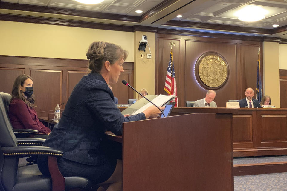 Rep. Priscilla Giddings responds to questions from ethics committee attorney Christopher McCurdy during a hearing to determine if she violated the Idaho Legislature's ethics rules by publicizing the name of a young intern who accused one of Giddings' fellow lawmakers of rape in Boise, Idaho., on Monday, Aug. 2, 2021. An Idaho lawmaker accused of violating ethics rules by publicizing the name of an alleged rape victim in disparaging social media posts and then allegedly misleading lawmakers about her actions, said in an ethics hearing Monday that she did nothing wrong and claimed the allegations against her were politically motivated. (AP Photo/Rebecca Boone)