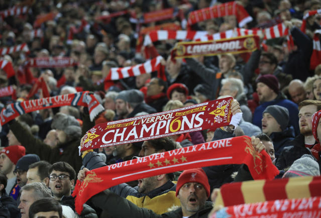 Liverpool fans are seen before the English Premier League soccer match between Liverpool and Everton at Anfield Stadium, Liverpool, England, Wednesday, Dec. 4, 2019. (AP Photo/Jon Super)