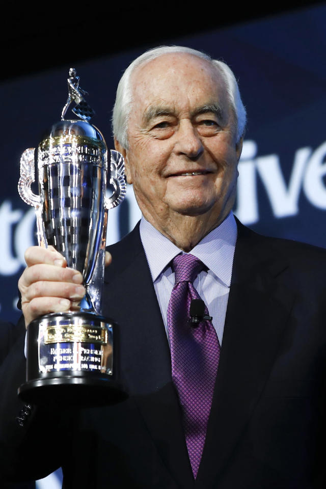 "FILE - In this Jan. 16, 2019, file photo, Roger Penske holds his ""Baby Borg"" trophy in Detroit. Indianapolis Motor Speedway and the IndyCar Series have been sold to Penske Entertainment Corp. in a stunning announcement that relinquishes control of the iconic speedway from the Hulman family after 74 years. (AP Photo/Paul Sancya, File)"