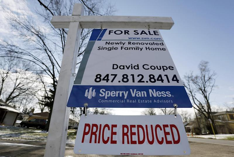 """In this Saturday, Jan. 5, 2013, photo, a """"for sale"""" sign is seen outside a home in Glenview, Ill.  Average U.S. rates on fixed mortgages rose this week but remained close to record lows. Cheap mortgages have made home buying more affordable and have helped drive a housing recovery.  (AP Photo/Nam Y. Huh)"""