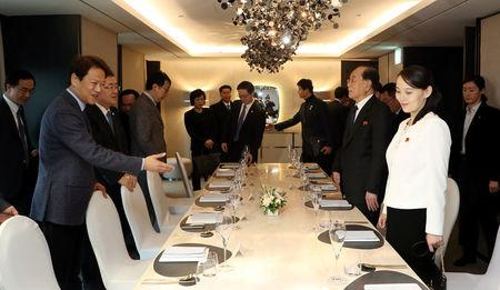 Im Jong-seok, the Chief Presidential Secretary for President of South Korea Moon Jae-in, leads Kim Yo Jong, the sister of North Korea's leader Kim Jong Un, during a banquet at a hotel in Seoul, South Korea, February 11, 2018. The Presidential Blue House/Yonhap via REUTERS