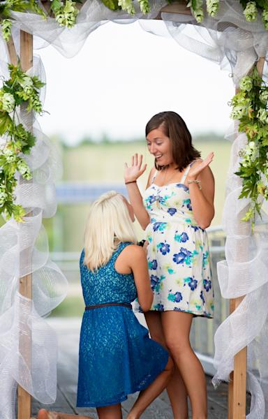 In this Sept. 11, 2013 photo provided by Innamorata Photography, Megan Smith, left, proposes to Lindsey Wagoner, who later changed her last name to Smith, in Chattanooga, Tenn. Winning a contest held by the American Civil Liberties Union, they and four other couples will get logistical and financial help from the ACLU to get married the week of April 28, 2014 in one of the 17 states, plus Washington D.C., which do allow gay marriage. The Smiths had a wedding celebration in Chattanooga on Sunday, March 30, 2014 even though Tennessee doesn't recognize gay marriages, and they plan to be legally wed in a few weeks in Washington, D.C., outside the U.S. Supreme Court building. (AP Photo/Innamorata Photography, Melody Hood)