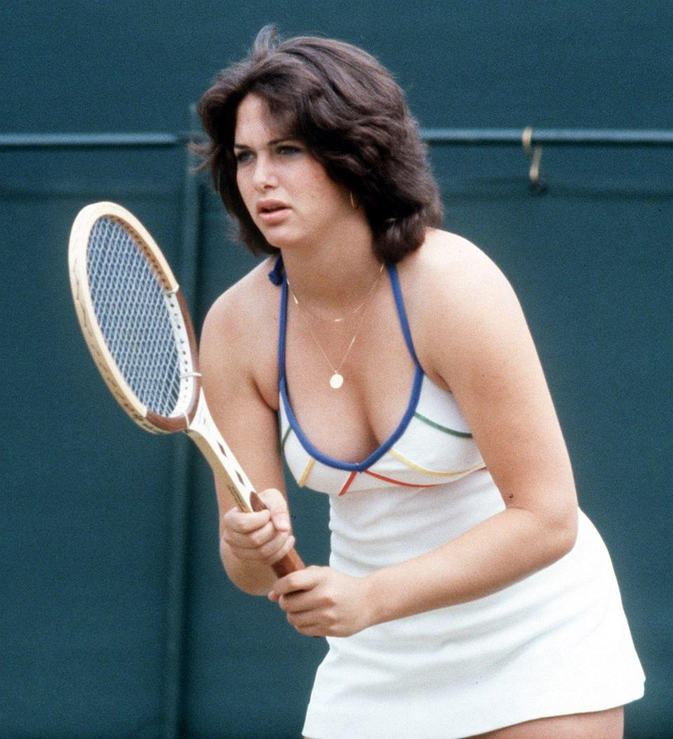 """<p>Linda Siegel, the 18-year-old Californian who shocked Wimbledon fans at the time with her halter-neck dress, competes against Billie Jean King in 1975. Siegel lost the match, but made front pages the next day after <a href=""""https://www.washingtonpost.com/archive/sports/1979/06/29/wimbledon-wont-forget-siegel/76611fa8-9873-401c-bf95-1b0ffab359d4/"""" rel=""""nofollow noopener"""" target=""""_blank"""" data-ylk=""""slk:experiencing several wardrobe malfunctions"""" class=""""link rapid-noclick-resp"""">experiencing several wardrobe malfunctions</a> during the competition. </p>"""