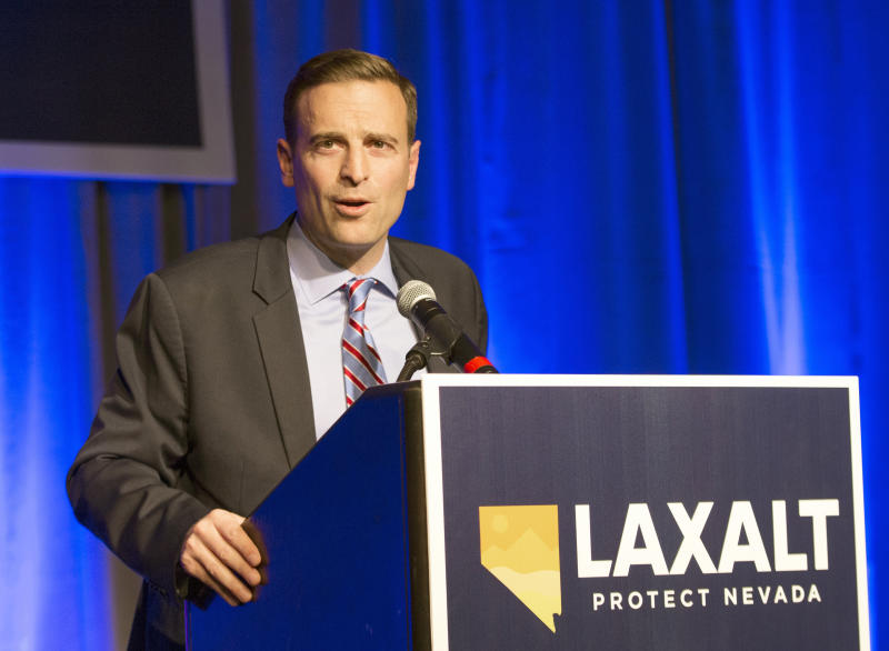 "FILE - In this Nov. 6, 2018 file photo Republican Adam Laxalt concedes the Nevada governor's race to Democrat Steve Sisolak in Reno, Nev. Sisolak is expressing outrage and vowing to tighten marijuana licensing oversight after reports that a foreign national contributed to two top state political candidates last year in a bid to skirt rules to open a legal cannabis store. Sisolak declared Friday, Oct. 11, 2019 there's been ""lack of oversight and inaction"" by the state Marijuana Enforcement Division. (AP Photo/Tom R. Smedes,File)"