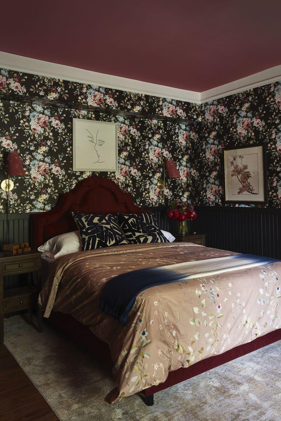"""<p>Edgy meets traditional in this statement-making room by <a href=""""https://www.lhdesigned.com/"""" rel=""""nofollow noopener"""" target=""""_blank"""" data-ylk=""""slk:Linda Hayslett"""" class=""""link rapid-noclick-resp"""">Linda Hayslett</a>. Called the Maddi-Mia Room after Hayslett's mother and dog, the room features a fun mixture of color and pattern thanks to the floral <a href=""""https://clarke-clarke.sandersondesigngroup.com/"""" rel=""""nofollow noopener"""" target=""""_blank"""" data-ylk=""""slk:Clarke & Clarke"""" class=""""link rapid-noclick-resp"""">Clarke & Clarke</a> wallpaper and the berry-colored platform bed from Wayfair's <a href=""""https://www.wayfair.com/brand/bnd/kelly-clarkson-home-b53111-masterClID~804.html"""" rel=""""nofollow noopener"""" target=""""_blank"""" data-ylk=""""slk:Kelly Clarkson Home Collection"""" class=""""link rapid-noclick-resp"""">Kelly Clarkson Home Collection</a>. The room offers a variety of budget-friendly finds, including bedding from <a href=""""https://www.zarahome.com/"""" rel=""""nofollow noopener"""" target=""""_blank"""" data-ylk=""""slk:Zara Home"""" class=""""link rapid-noclick-resp"""">Zara Home</a> and a rug and framed print from <a href=""""https://www.homegoods.com/locator?cid=HOM:PaidSearchBrand:GGL:NA:SA-71700000071579576-homegoods&gclsrc=aw.ds&&gclid=CjwKCAjwtJ2FBhAuEiwAIKu19lCDt8oIrgpHA-QoFENOdwoNBsbS-vnz0PTIsgRFO2m1__BvrPisKhoCYuoQAvD_BwE&pcrid=460207990447&mkwid=s%7Cdc&pmt=e&pkw=homegoods"""" rel=""""nofollow noopener"""" target=""""_blank"""" data-ylk=""""slk:HomeGoods"""" class=""""link rapid-noclick-resp"""">HomeGoods</a>. Hayslett told us: """"Diversity will make the design industry flourish and give creativity the growth it needs."""" </p>"""