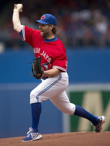 Toronto Blue Jays starting pitcher R.A. Dickey pitches during the first inning of a baseball game against the Detroit Tigers in Toronto, on Monday July 1, 2013. (AP Photo/The Canadian Press, Frank Gunn)