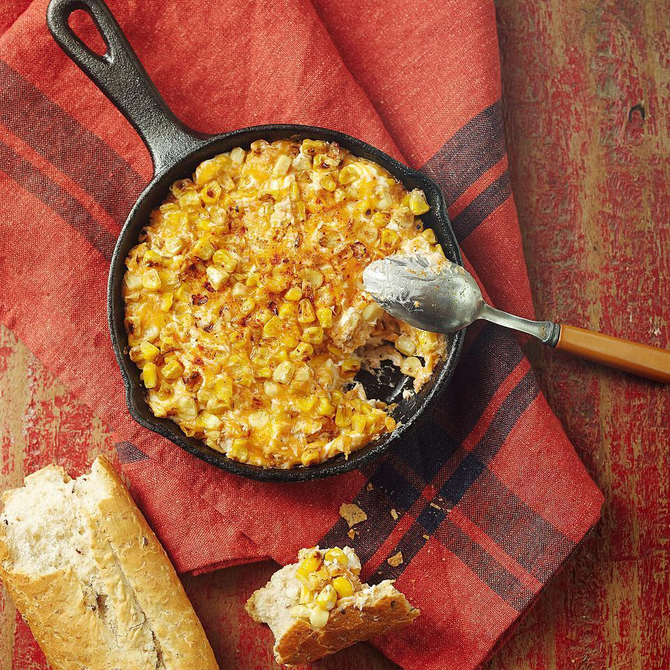 <p>Inspired by queso fundido--melted Mexican cheese dip--this corn and warm Cheddar cheese dip is great with toasted baguette.</p>