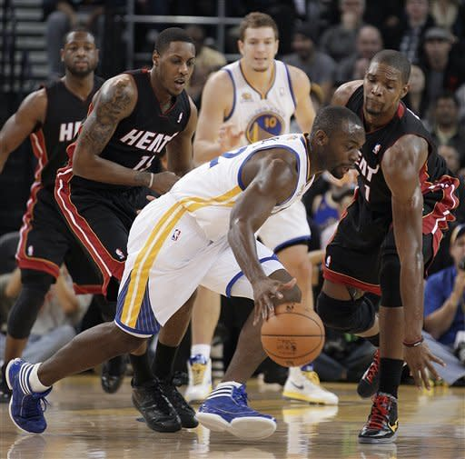 Golden State Warriors' Charles Jenkins drives against Miami Heat's Chris Bosh (1) during the first half of an NBA basketball game Tuesday, Jan. 10, 2012, in Oakland, Calif. (AP Photo/Ben Margot)