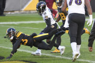 Pittsburgh Steelers cornerback Joe Haden (23) dives into the end zone in front \of Baltimore Ravens wide receiver Marquise Brown (15) with a touchdown after intercepting a pass during the first half of an NFL football game, Wednesday, Dec. 2, 2020, in Pittsburgh. (AP Photo/Don Wright)