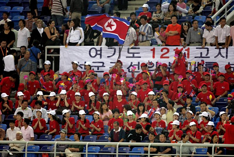 File photo taken in September 2007 shows North Korean cheerleaders warming up prior to a 2007 FIFA Women's World Cup match between North Korea and Sweden in Tianjin