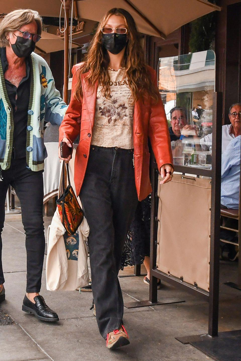 <p><strong>6 November </strong>Bella Hadid went for an off-duty look in a statement orange leather blazer. </p>