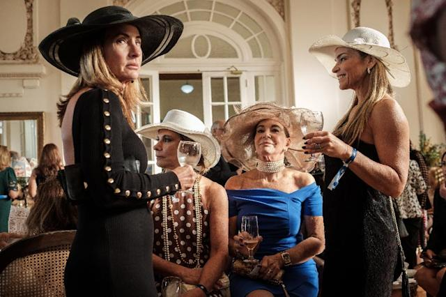 Exclusive members of the Jockey Club hippodrome, including 70-year-old Teresa Aczel Quattrone (2-R), wait at the Salao das Rosas, or Roses Room, for the Grande Premio Brasil, Brazil's biggest horse race of the year (AFP Photo/Yasuyoshi CHIBA)