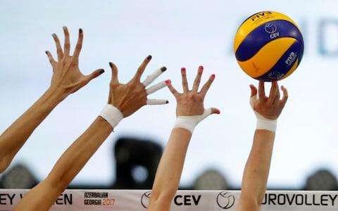 No wonder those volleyball players look so pleased with themselves - Credit: SERGEI ILNITSKY/EPA