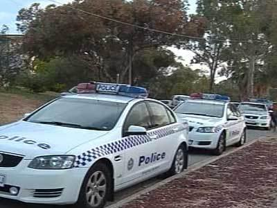 <p>Police cars line the street at the scene of the Para Hills home invasion.</p>