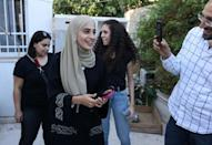 Palestinian activist Mona el-Kurd smiles after being released on Sunday afternoon