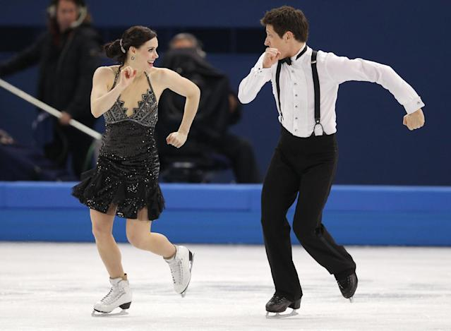 Tessa Virtue and Scott Moir of Canada compete in the ice dance short dance figure skating competition at the Iceberg Skating Palace during the 2014 Winter Olympics, Sunday, Feb. 16, 2014, in Sochi, Russia. (AP Photo/Vadim Ghirda)